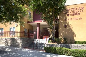 Castelar Apartments with 625 N Hill St on exterior, double staircase, and sidewalk
